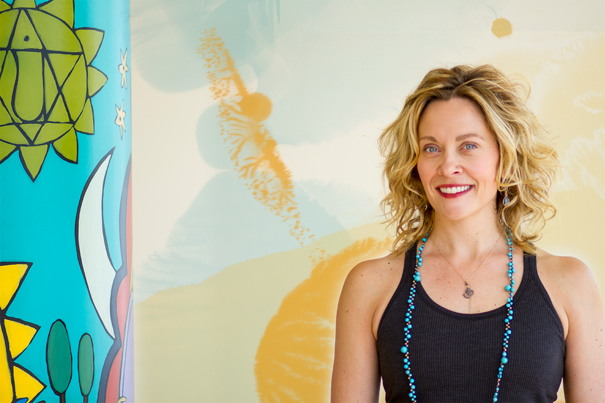Betsy Brandl Rippentrop, Ph.D. (Dr. Yoga Momma) owner of Heartland Yoga in Iowa City, IA.